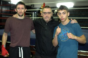 Johnny Eames flanked by new signings Michael O'Rourke (L) and Danny Arnold (R) at the new Champions TKO Boxing Gym in London